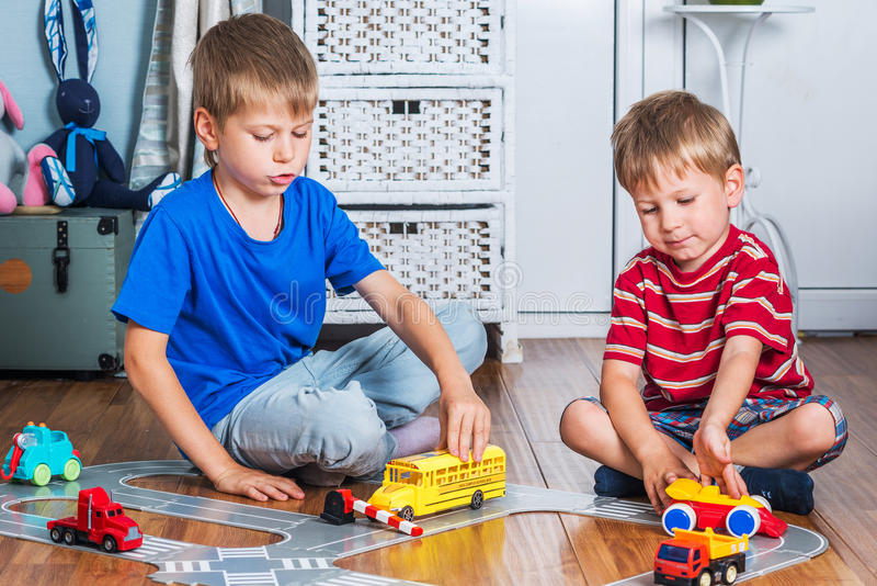 Two brothers plays stock photo