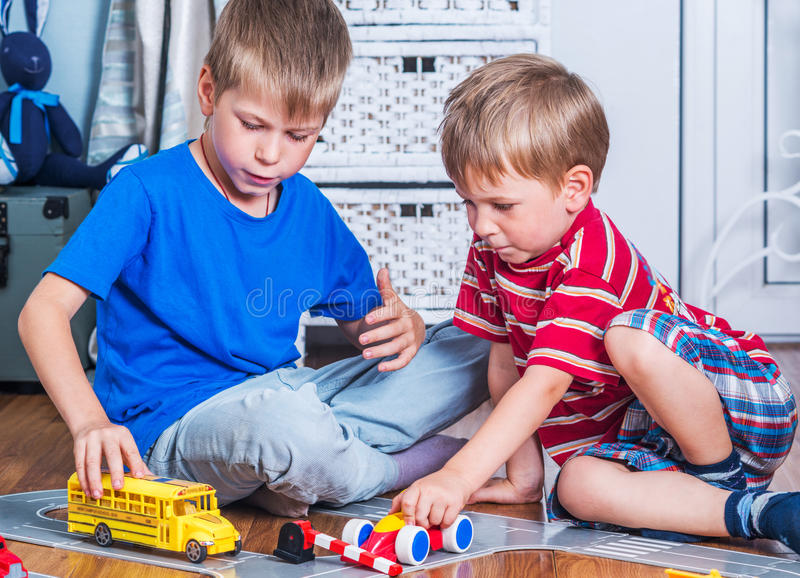 Two brothers plays stock image