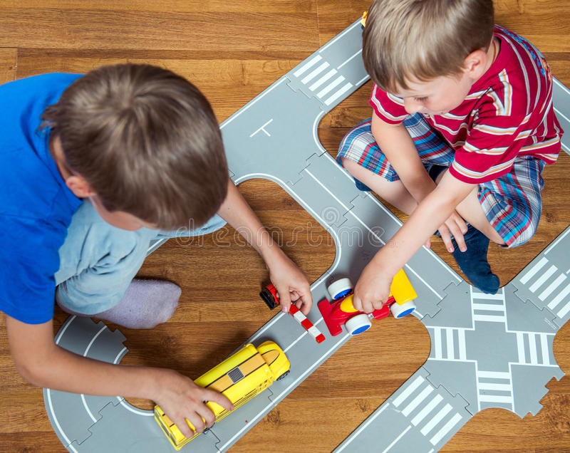 Two brothers plays stock images
