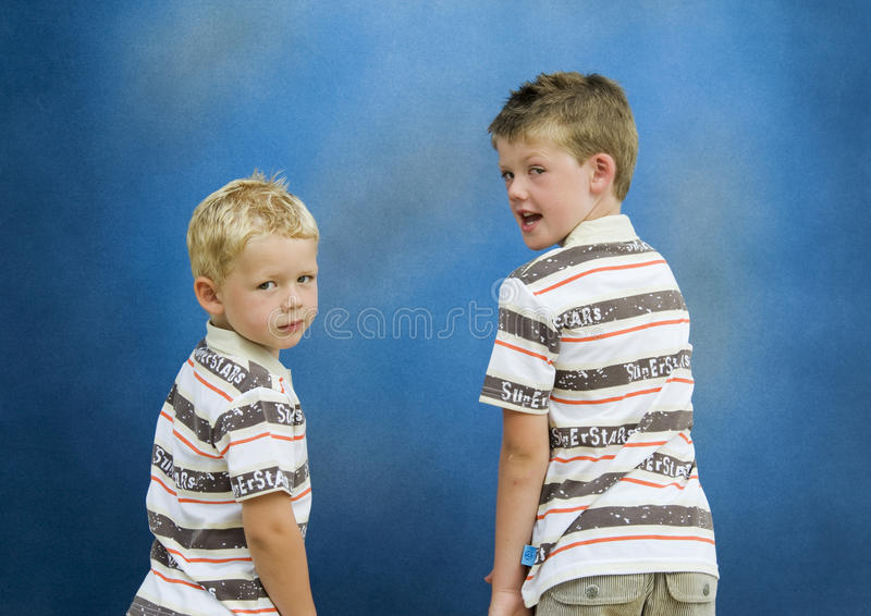 Download Two Brothers Turning Back stock photo. Image of brothers - 12189418
