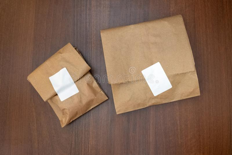 Two brown color paper bag. Wooden background and texture stock photos