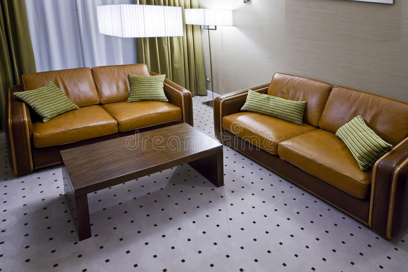 Two brown leather sofas in living room stock images