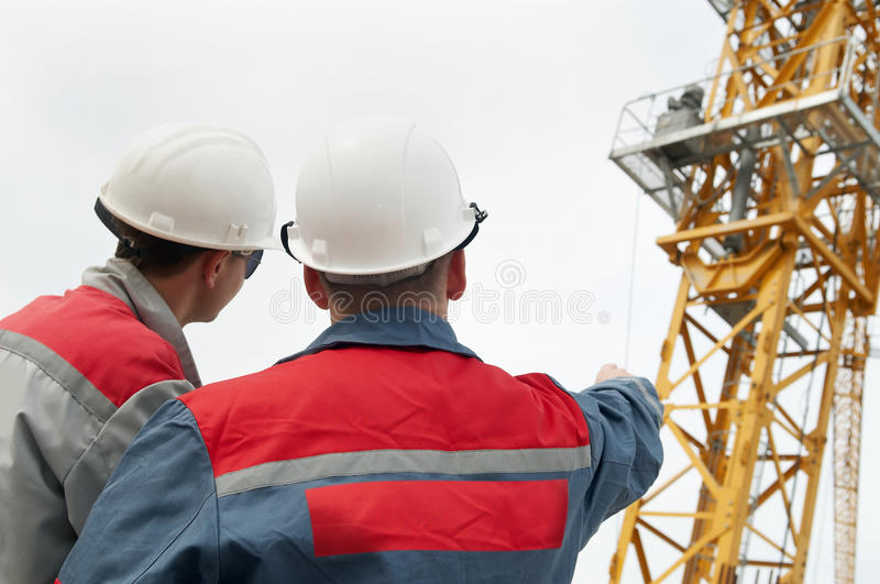 Two builders at construction site royalty free stock photos