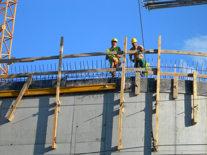 Download Two Builders. Workers On Top Of A Constructed Building Stock Photo - Image: 1163704