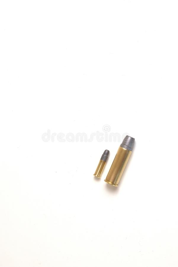 Two bullets of different caliber, one is a .22, the other a .44 Magnum heavyweight. stock photo
