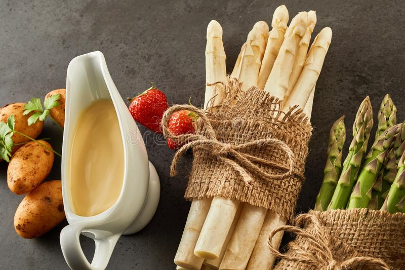 Two bunches of fresh asparagus spears in hessian royalty free stock photo