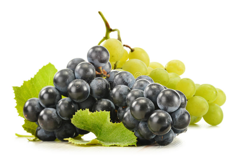 Two bunches of red and white grapes on white royalty free stock images