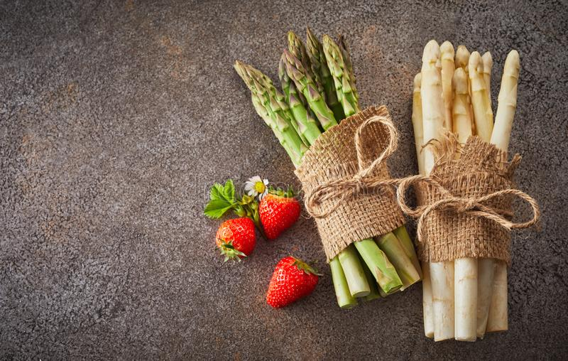 Two bundles of fresh white and green asparagus stock photography