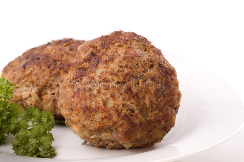 Two Burger. With blob of mustard and parsley on plate isolated on white royalty free stock images