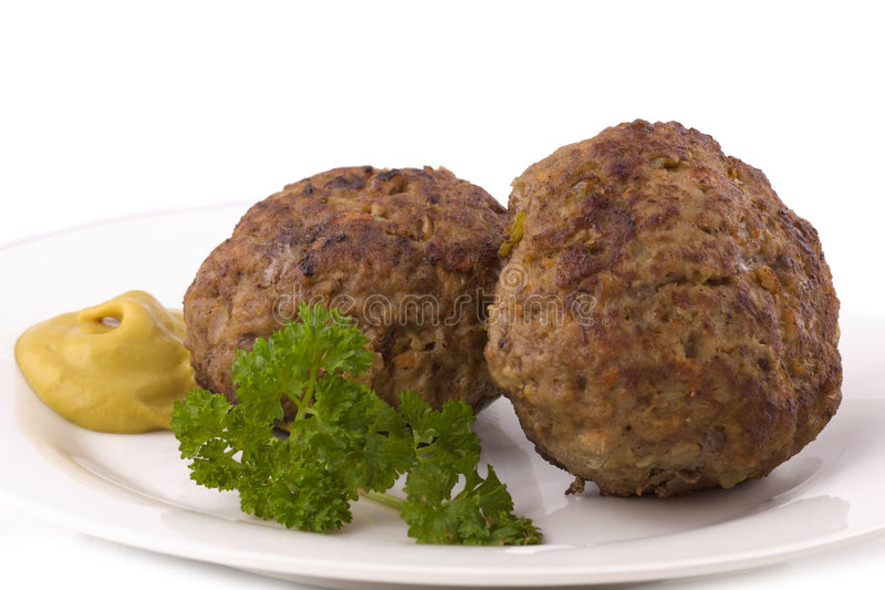 Two Burger. With blob of mustard and parsley on plate isolated on white stock photo