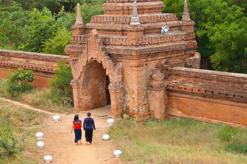 Two Burmese girls walking towards a temple in Bagan, Myanmar Burma royalty free stock photography