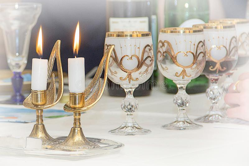 Two burning candles. Seder table, glasses with the red wine, Seder, Sederabend the Jewish Passover royalty free stock images
