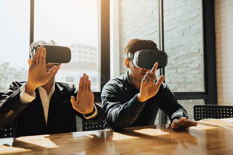 Two business business persons with virtual reality headsets in the office.  royalty free stock image