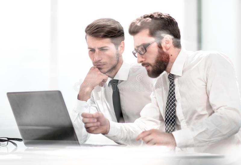 Two business colleagues discuss online information stock image