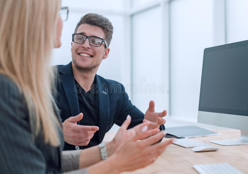 Two business colleagues discussing a work project at the desktop royalty free stock photography