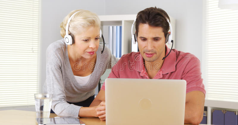 Two business colleagues having a video conference on laptop royalty free stock photos