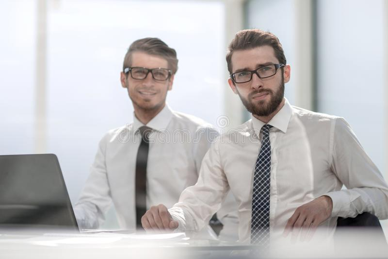 Two business colleagues sitting at the Desk. royalty free stock image