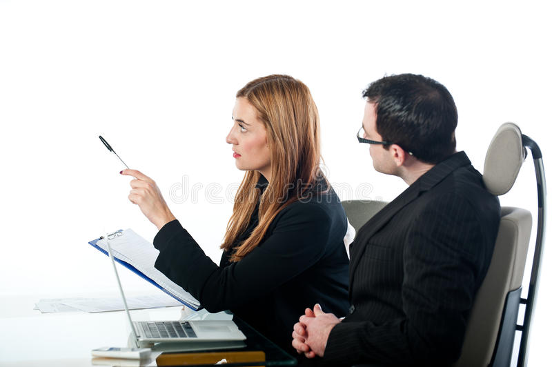 Two Business Colleagues Working And Pointing Royalty Free Stock Photos