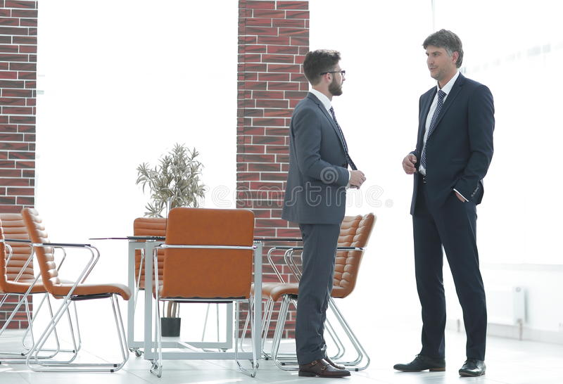 Two business executives talking about business in the office. royalty free stock images