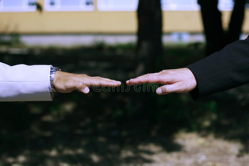 Two business hands in flat straight position stock photos