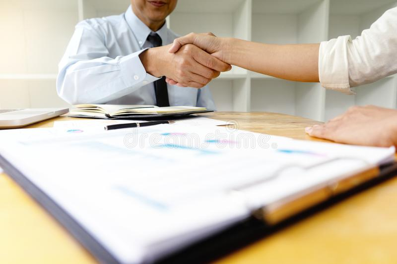 Two Business handshake and business people. After discussing good deal of Trading contract and new projects for both companies, success, partnership, co worker royalty free stock photography