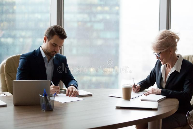 Two business male and woman meeting in office stock images