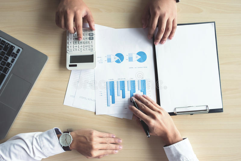 Two Business man or accountant working Financial investment, writing report Analyze business and market growth and calculating co royalty free stock image