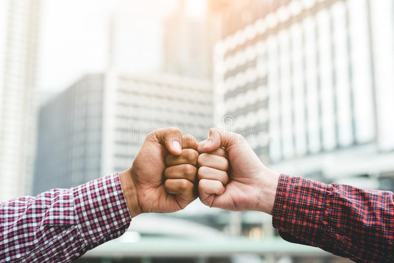 Two business man hands use fist bump for succes teamwork corporate royalty free stock photos