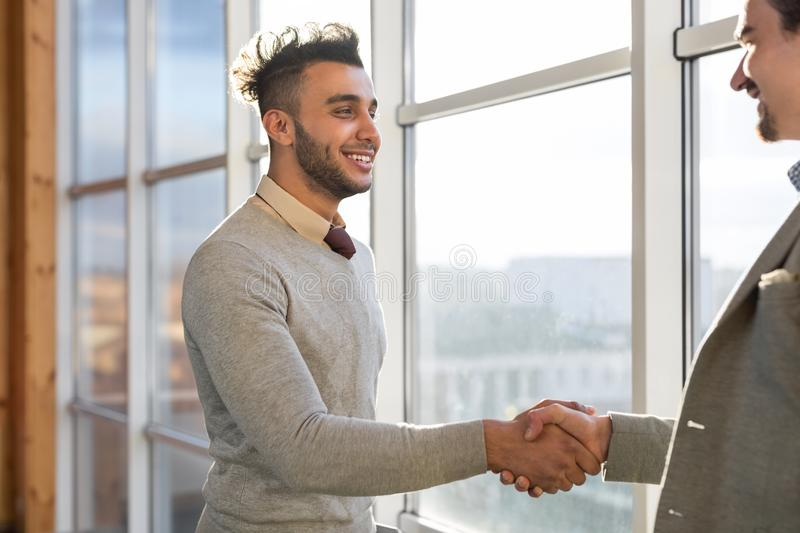 Two Business Man Shake Hand Agreement Coworking Center Business Team Coworkers Stand In Front Big Panoramic Window stock images