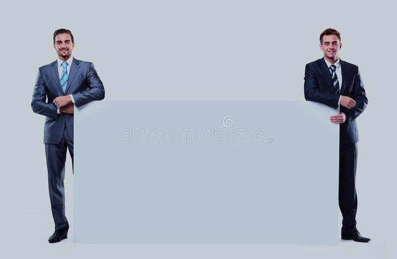 Two business man showing blank signboard, isolated over white background. Two business men showing blank signboard, isolated over white background stock images