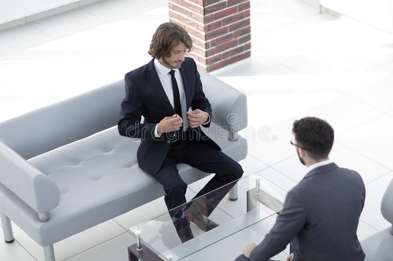 Two business man before the beginning of the dialogue. Two business men before the beginning of dialogue in the workplace royalty free stock image