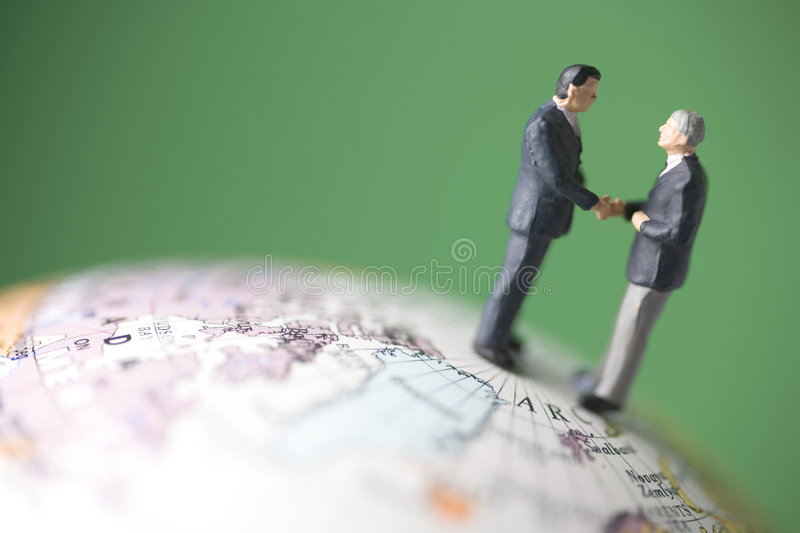 Two business men shake hands royalty free stock images