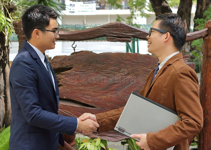 Two business men shaking hands , Successful business concept royalty free stock photography