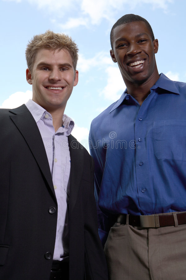 Two business men smiling