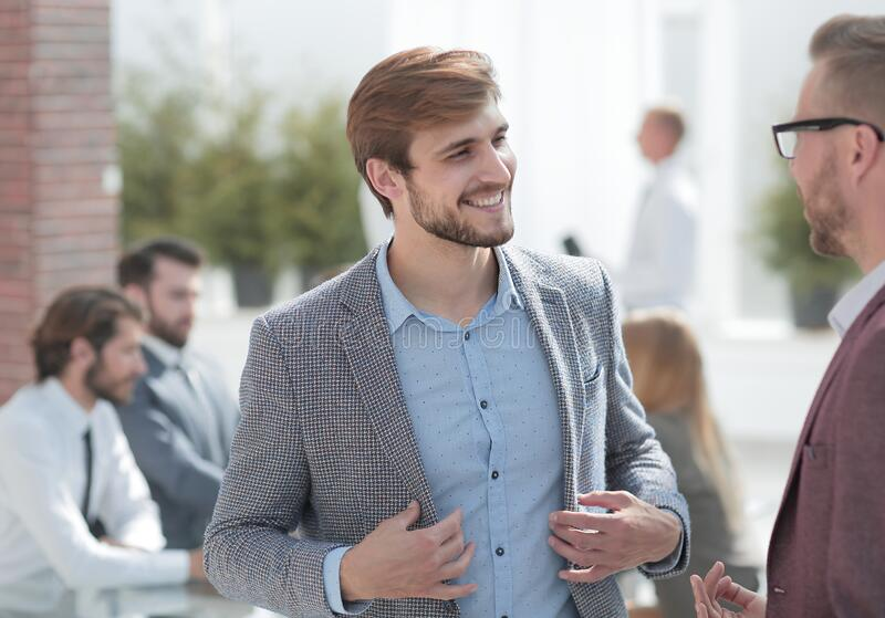Two business men talking standing in the office. Photo with copy space royalty free stock images