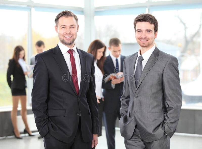 Two business men working together stock photos