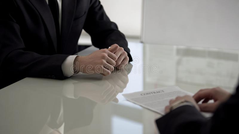 Two business partners discussing contract, creating startup together, teamwork. Stock photo royalty free stock photo
