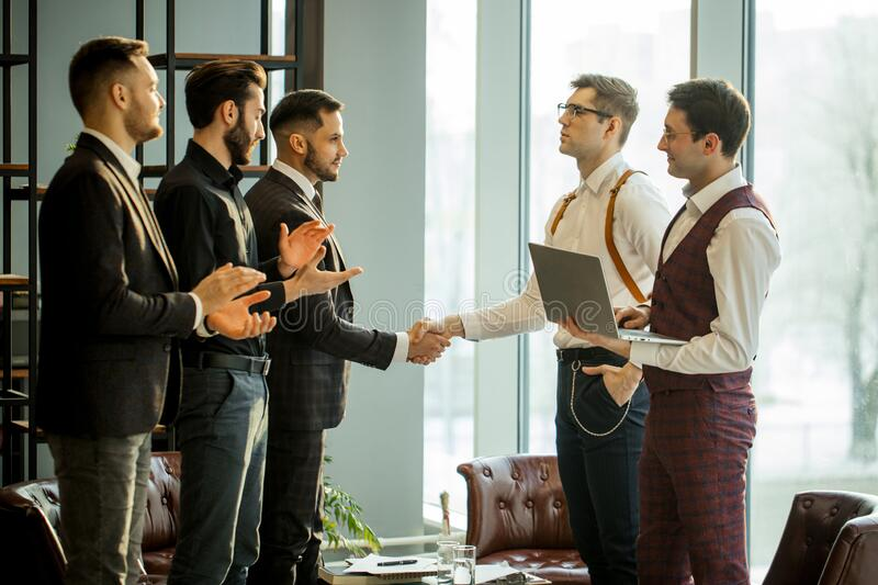 Two business partners shaking hands stock photography
