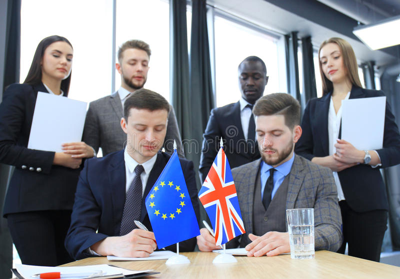 Two business partners signing a document. The European Union and Great britian. Brexit. royalty free stock images