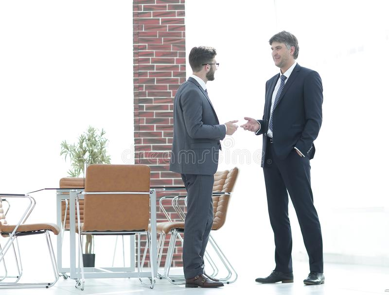 Two business executives talking about business in the office. stock image