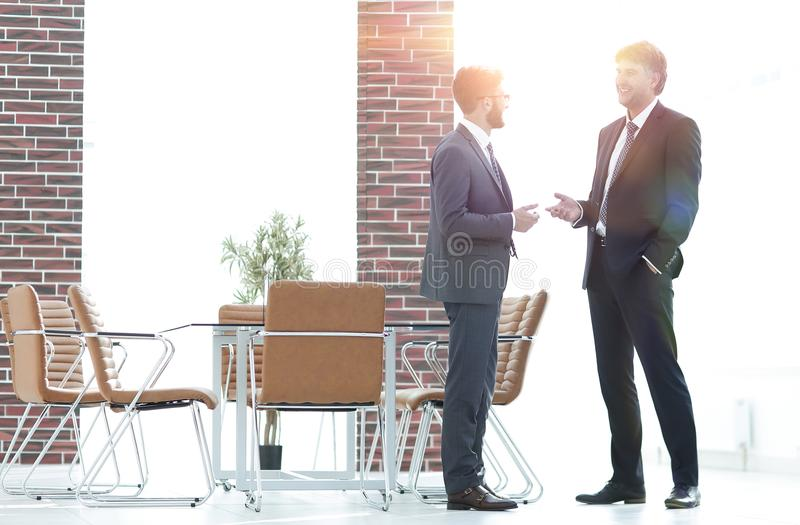 Two business executives talking about business in the office. royalty free stock photos