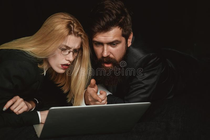 Two business partners working with laptop together. Couple guy and girl surfing internet in laptop. Portrait of business stock photos