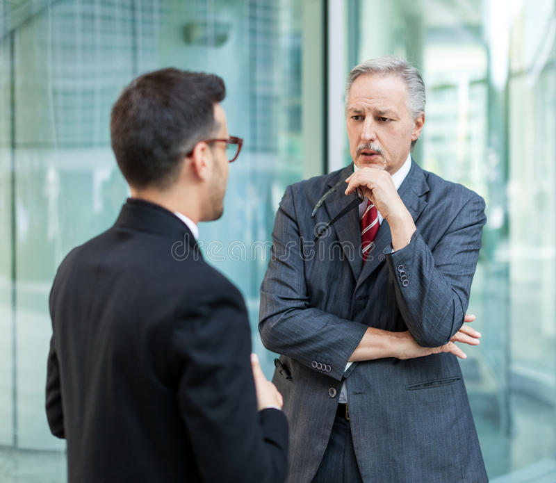 Two business people discussing outdoor royalty free stock images