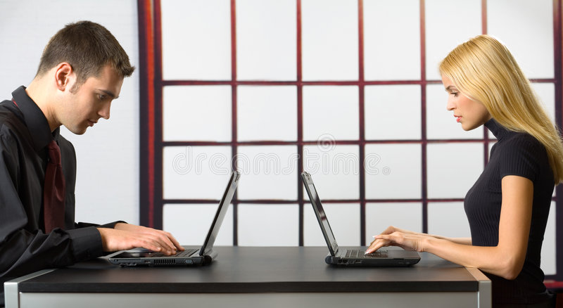 Download Two Business People On Laptops Stock Photo - Image: 2408588