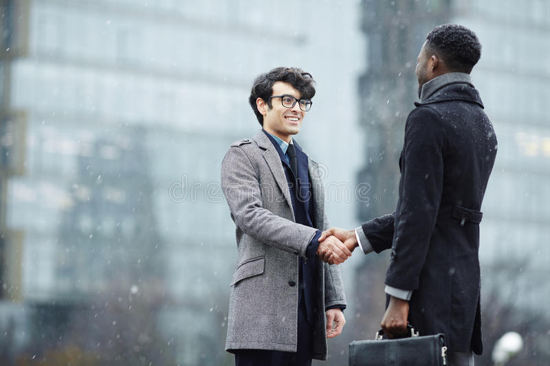 Two Business People Meeting in Street stock photos
