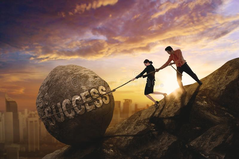 Business people pulling success word royalty free stock photography