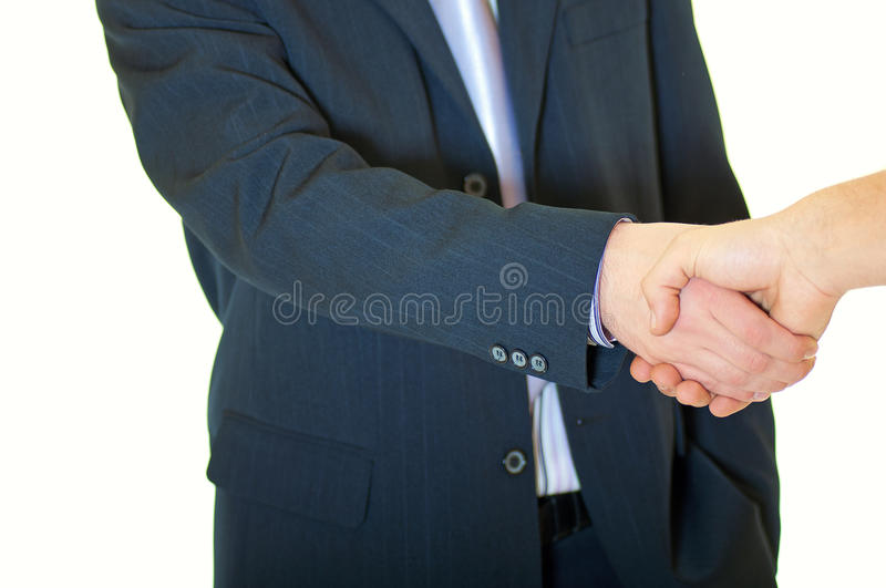 Two business people shaking hands over a new deal stock image