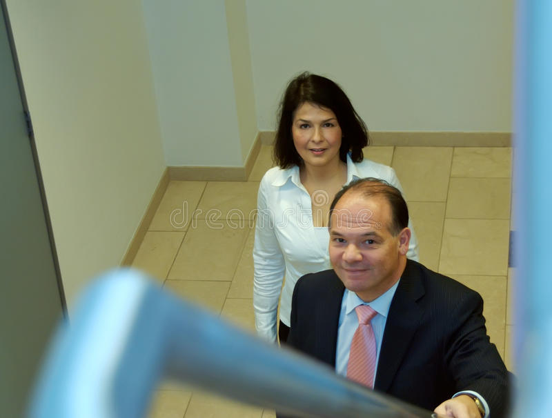 Two business people at stairs stock photography