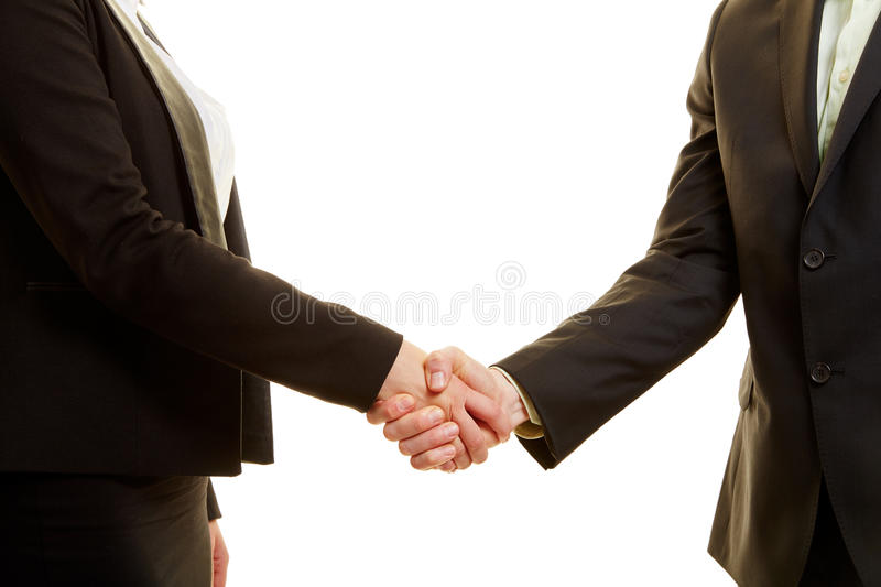 Two business people in a suit shaking hands royalty free stock photo