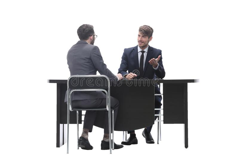Two business people talking sitting at a Desk stock photos